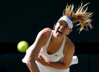Maria Sharapova of Russia serves during her match against Serena Williams of the U.S.A. at