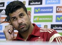 Spain striker Diego Costa gestures at the beginning of a news conference at Soccer City gr