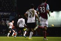 Tom Cleverly (L) shoots and scores against West Ham United during FA Cup third round socce