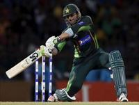 Pakistan's Shoaib Malik hits boundary during their first Twenty 20 cricket match against S
