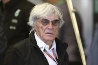 Formula One supremo Bernie Ecclestone walks in the Mercedes team garage during the third p