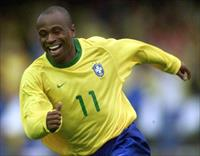 Brazilian striker Edilson celebrates his goal against Chile during their qualifying match