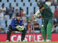 South Africa's Hashim Amla plays a shot as England's Jos Buttler looks on during the third
