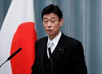 FILE PHOTO: Japan's Economy Minister Yasutoshi Nishimura attends a news conference at Prim