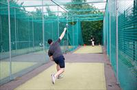 FILE PHOTO: People are seen playing cricket in nets at Clapham Common, following the outbr