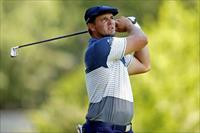 Jul 3, 2020; Detroit, Michigan, USA; Bryson DeChambeau plays his shot from the ninth tee d