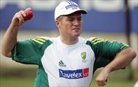 Australia's Stuart MacGill prepares to bowl a delivery during a practice session